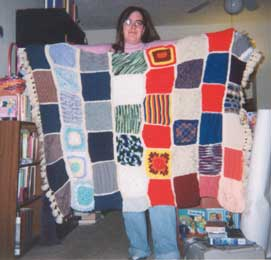 Image of the finished blanket from the first go-round, held by Suzanne/Segnbora-t
